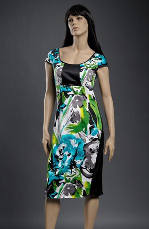 Pouzdrové šaty s děleným sedlem a velkým vzorem