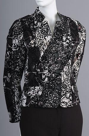 Elastické bavlněné sako se sametovým potiskem má patchworkový vzor.Fazona je s malým stojáčkem.