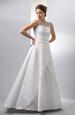 Svatební šaty na ramínka s vyšívaným sedlem a sukní