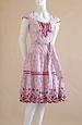 Krinolínové šaty s puntíčkem a vyšívaným volánem